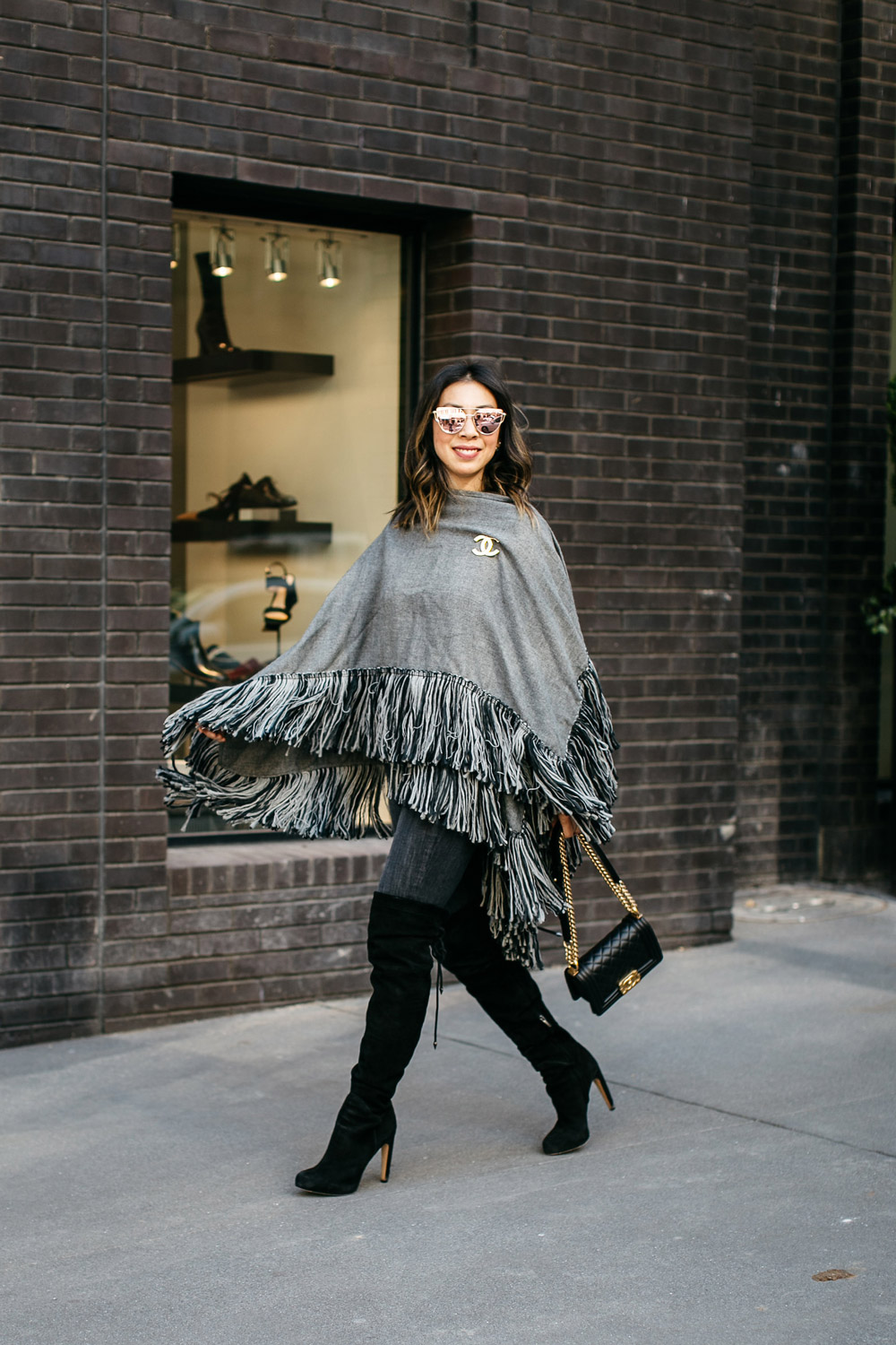who what wear grey fringe poncho with current elliot skinny jeans and sam edelman otk kayla boots