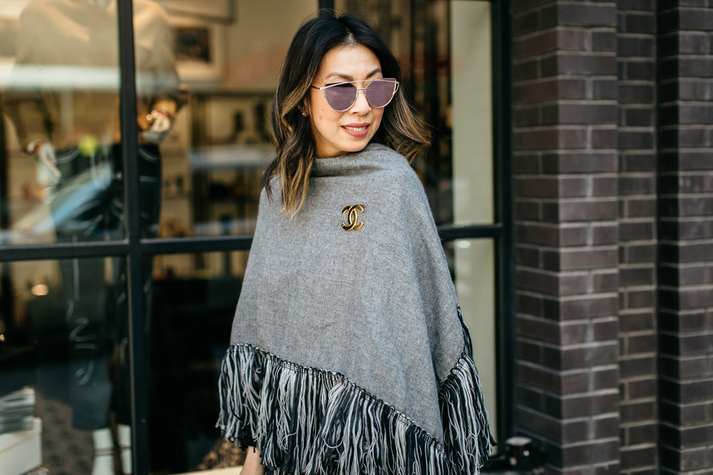 who what wear grey fringe poncho pinned with chanel cc brooch