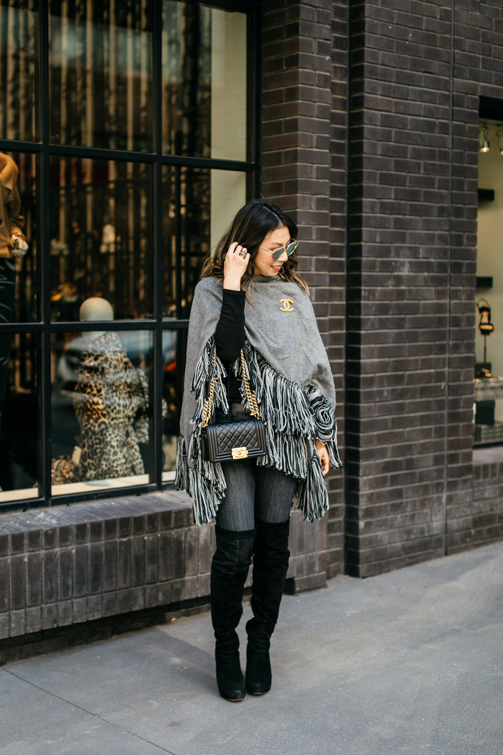 who what wear grey fringe poncho with current elliot skinny jeans and sam edelman otk kayla boots and chanel brooch boy bag