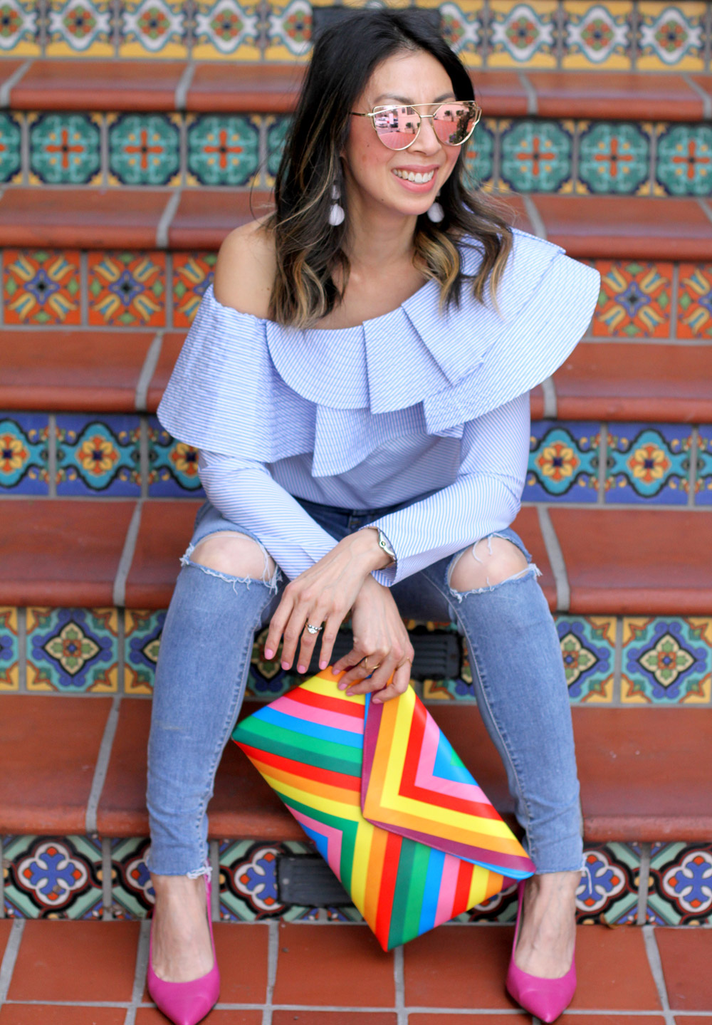 stylekeepers ruffle one shoulder top with ripped knee skinny jeans and rainbow clutch, pink pumps