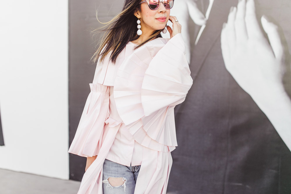 charles youssef pink pleated tunic top with boyfriend jeans and baublebar white crispin drop earrings