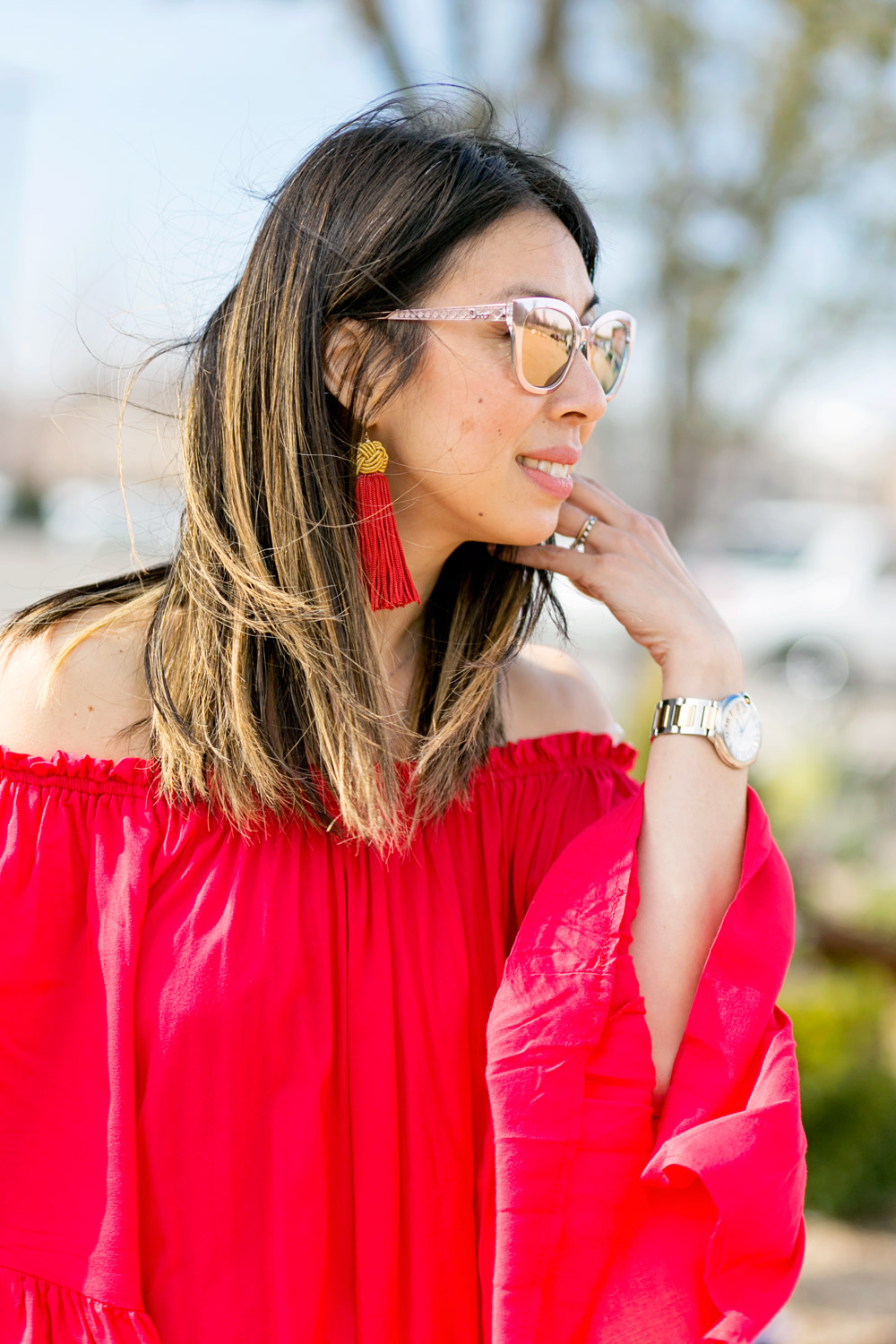 vanessa mooney red tassel earrings, off the shoulder top, dior diorama pink sunglasses