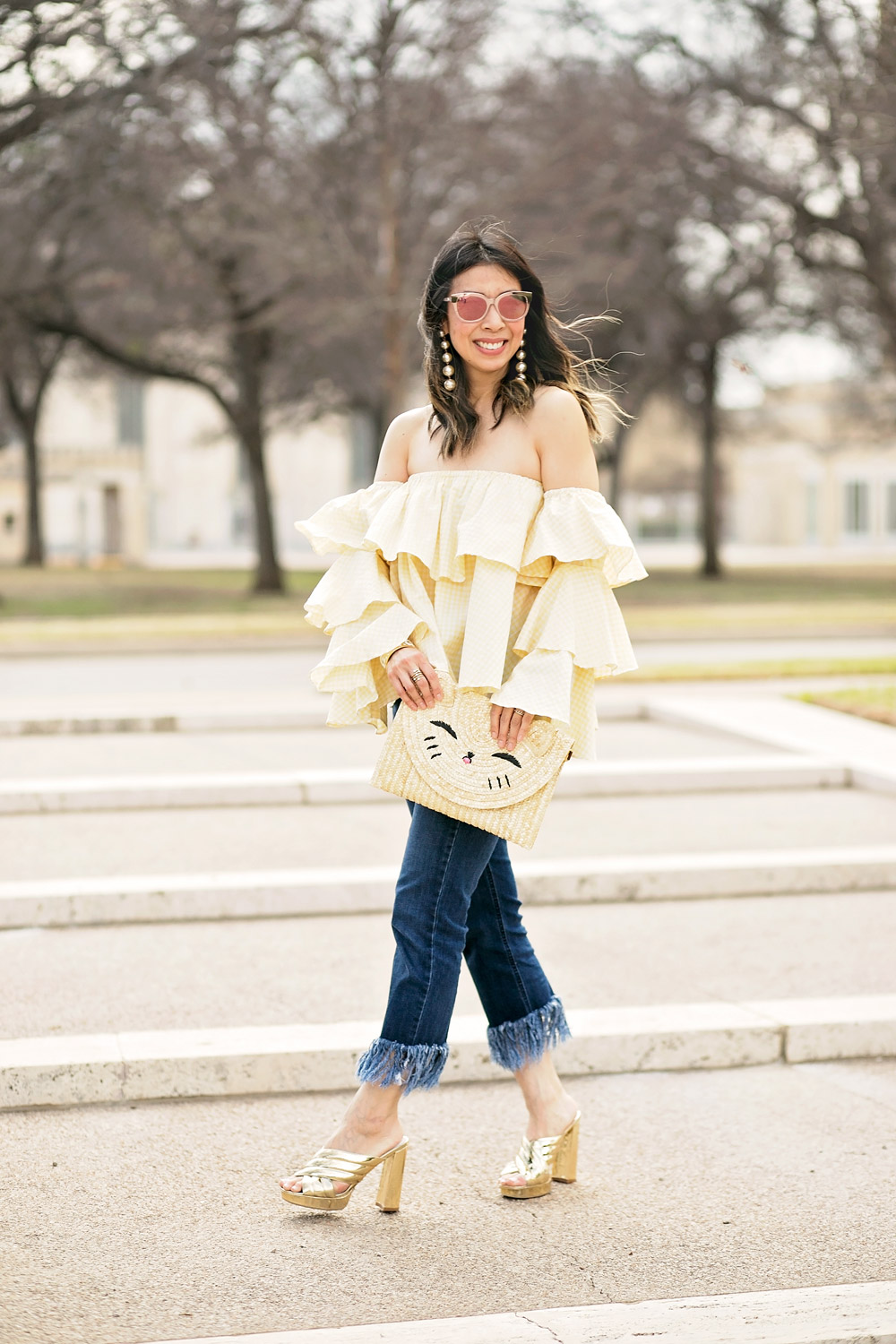 beehive fort worth off the shoulder gingham ruffle top, frayed hem jeans, happy cat straw clutch, gold slides