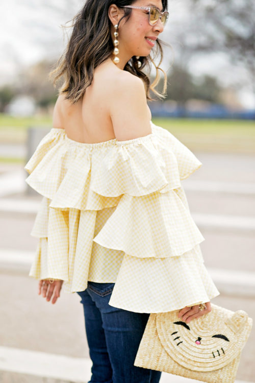 beehive fort worth off the shoulder gingham ruffle top and pearl drop statement earrings with happy cat straw clutch