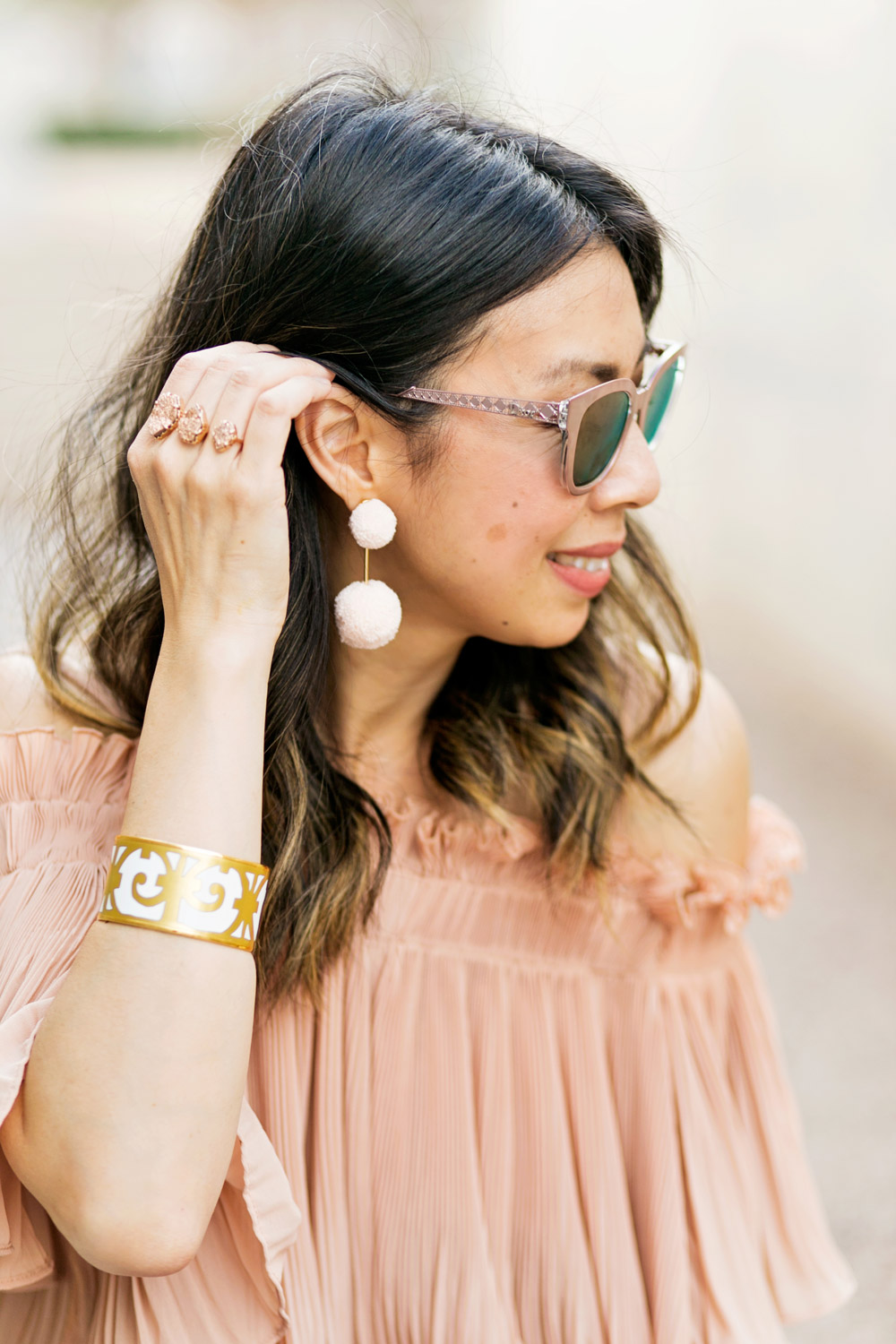 baublebar bahama pink pom pm earrings with endless rose pink pleated off the shoulder top and hermes balcones bangle, dior diorama pink mirrored sunglasses, spring outfit idea