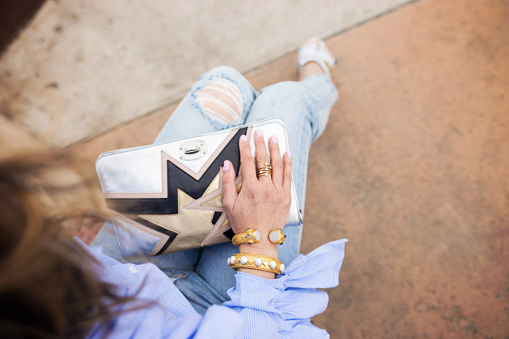 miu miu silver star clutch with julie vos bangles and levi's wedgie icon selvedge jeans