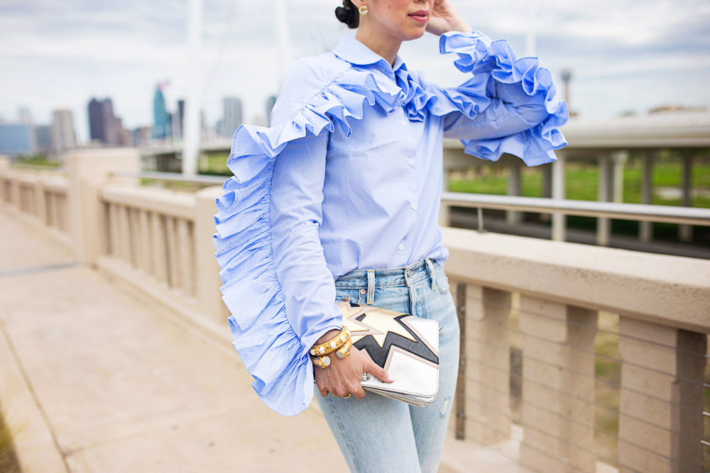 stylekeepers ruffle button up shirt with levi's wedgie icon selvedge jeans and miu miu silver start clutch at margaret hunt hill bridge dallas