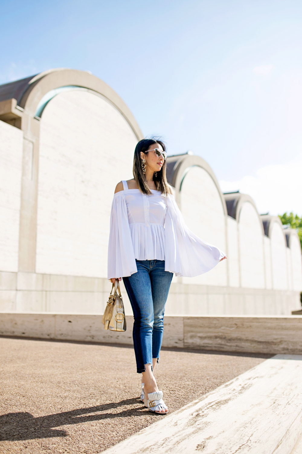 charles youssef pleated off the shoulder top with lele sadoughi windchime earrings and whbm tuxedo jeans, gucci marmont silver loafers, ysl mini muse gold