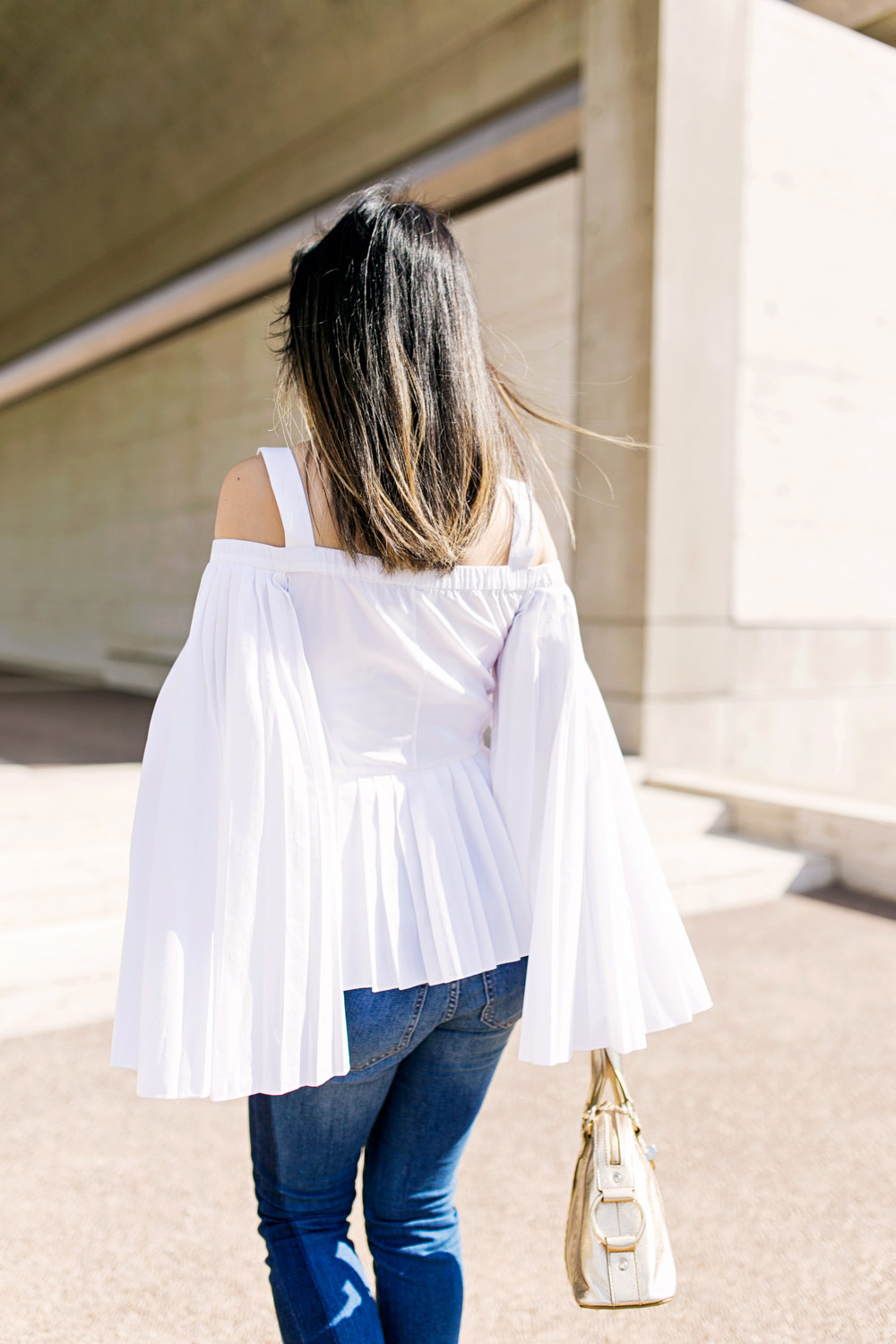 charles youssef pleated off the shoulder top with lele sadoughi windchime earrings and whbm tuxedo jeans