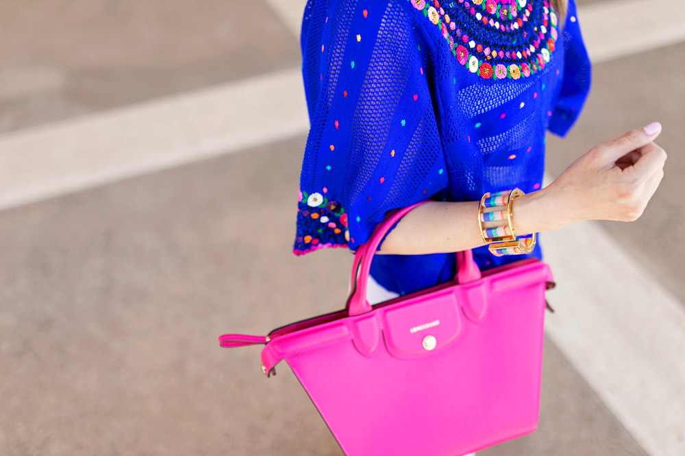 blue flower huipil with lele sadoughi tahitian nights striped fringe earrings and slider and pink longchamp bag