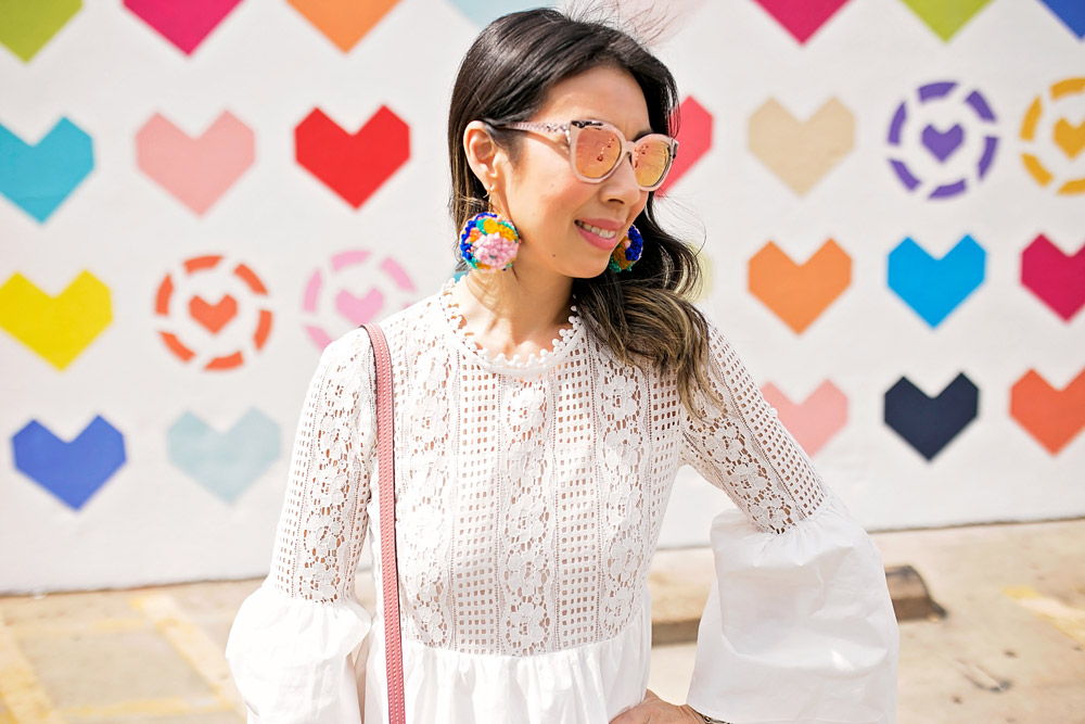 endless rose lace bell sleeve dress with pom pom earrings at liketoknow.it heart wall in dallas