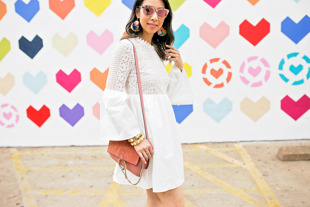 endless rose lace bell sleeve dress with pom pom earrings and pink chloe faye bag at liketoknow.it heart wall in dallas