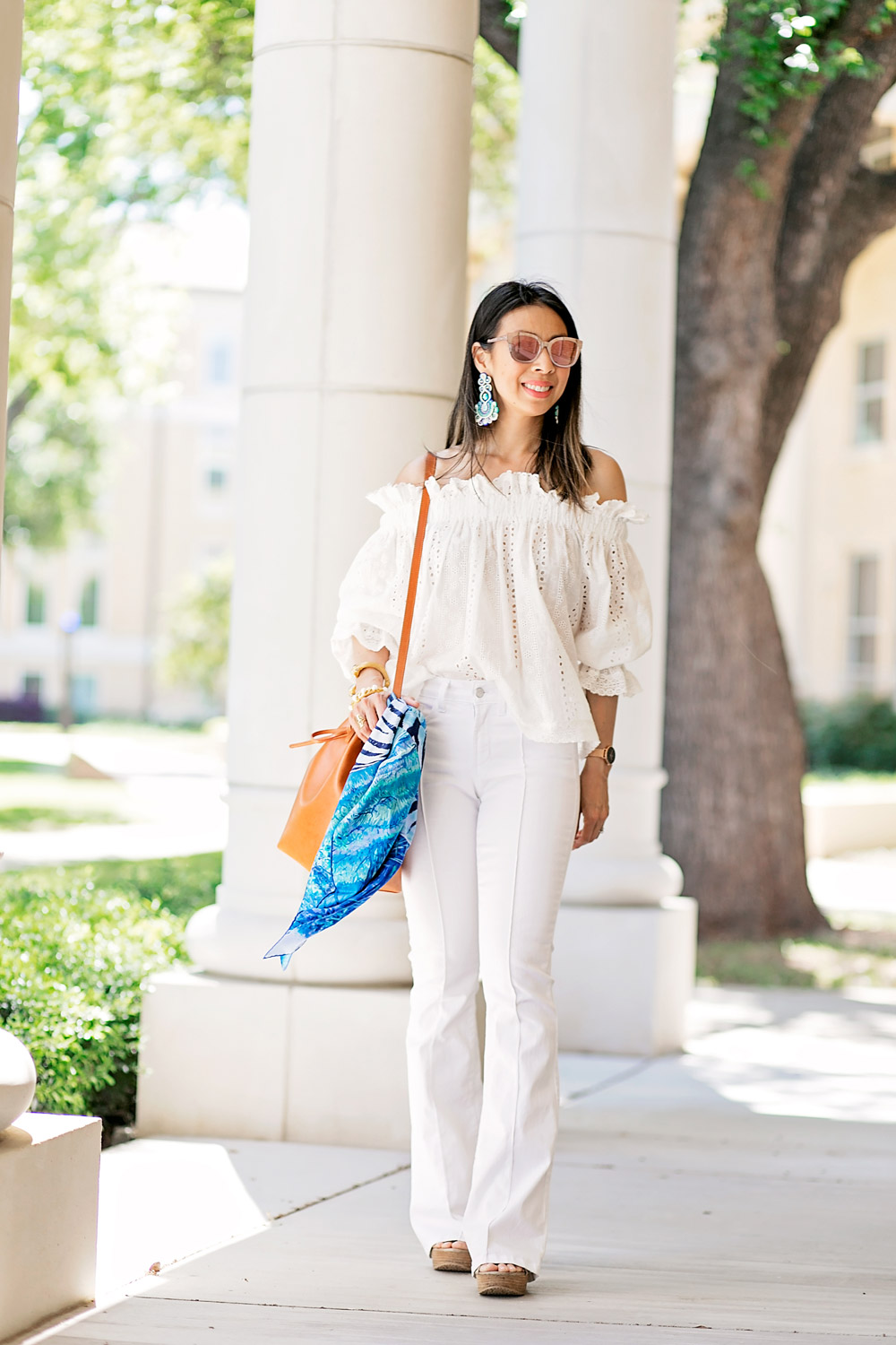 endless rose eyelet off the shoulder top with Alejandra Aspillaga statement earrings and mansur gavriel bucket bag, spring all white outfit idea