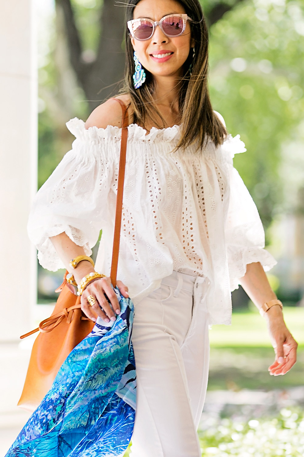 endless rose eyelet off the shoulder top and mansur gavriel bucket bag in camello with blue hermes scarf