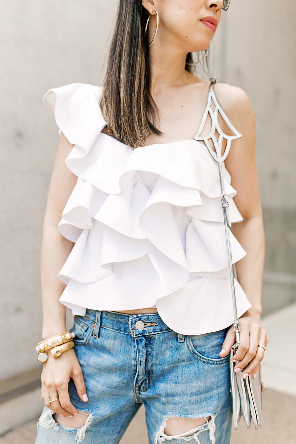 beehive one shoulder ruffle statement top with target ripped boyfriend jeans and miu miu star clutch