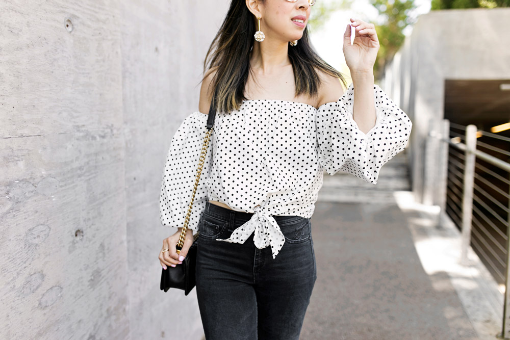 polka dot puff sleeve off the shoulder top with lele sadoughi plumeria drop earrings, rag and bone slit capri jeans in steel, gucci silver marmont mules