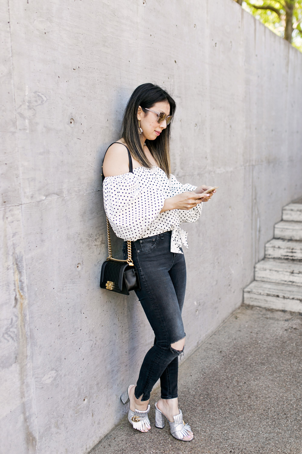 polka dot puff sleeve off the shoulder top with lele sadoughi plumeria drop earrings, rag and bone slit capri jeans in steel, gucci silver marmont mules and chanel boy bag