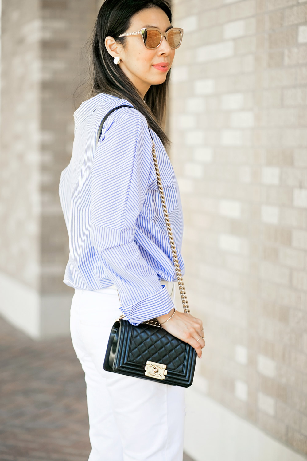 who what wear one shoulder button top with white boyfriend jeans and chanel boy bag
