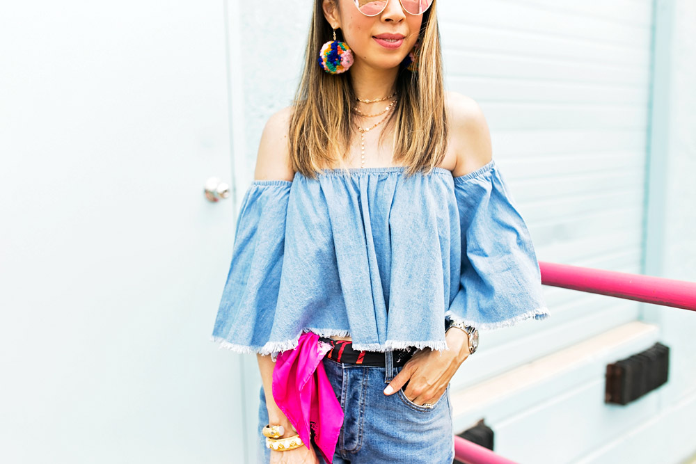 how to wear double denim off the shoulder frayed top DSTLD distressed mom jeans pom pom earrings