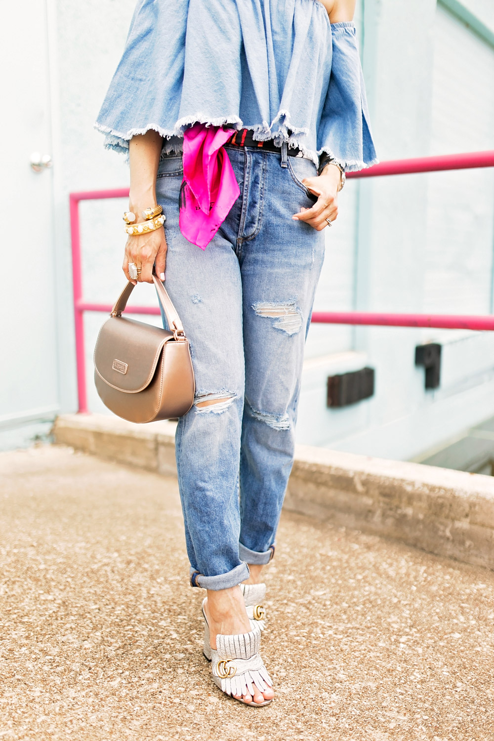 how to wear double denim off the shoulder frayed top DSTLD distressed mom jeans lipault pink gold saddle bag gucci silver kiltie heels