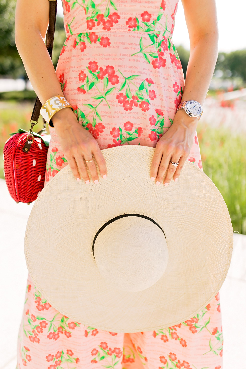 pink floral tiered maxi dress strawberry wicker bag cuyana oversized beach hat hermes balcons du guadalquivir bracelet cartier ballon blue watch