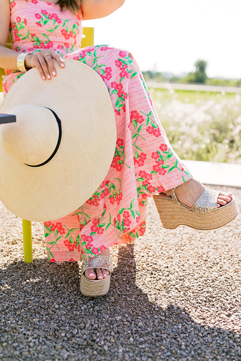 pink floral tiered maxi dress strawberry wicker bag cuyana oversized beach hat miu miu glitter platform espadrille sandals