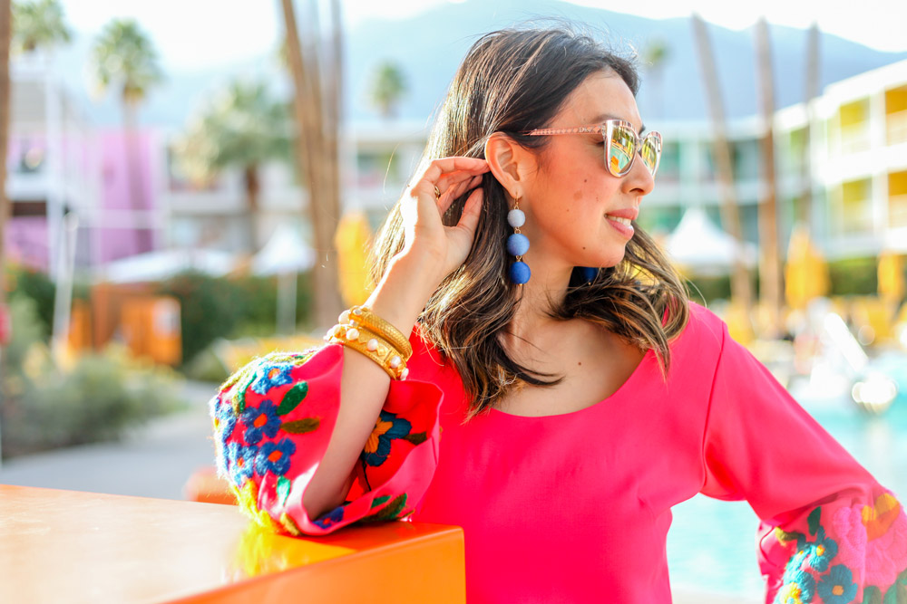 pink bell sleeve embroidered dress, blue ball drop earrings, julie vos bracelet stack in palm springs california