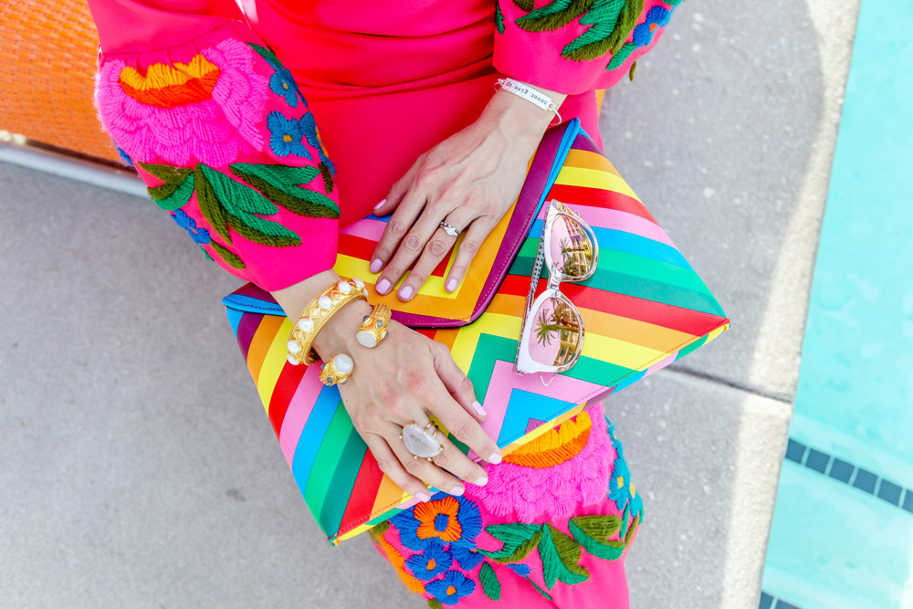 pink bell sleeve embroidered dress and rainbow clutch, dior diorama sunglasses, julie vos bracelet stack, kelly wearstler tamarindo ring