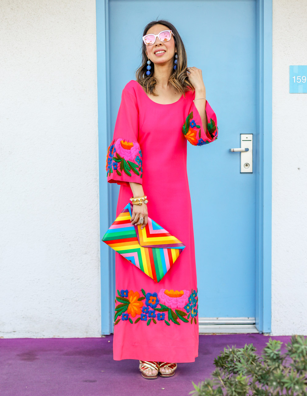 pink bell sleeve embroidered dress and rainbow clutch in palm springs california