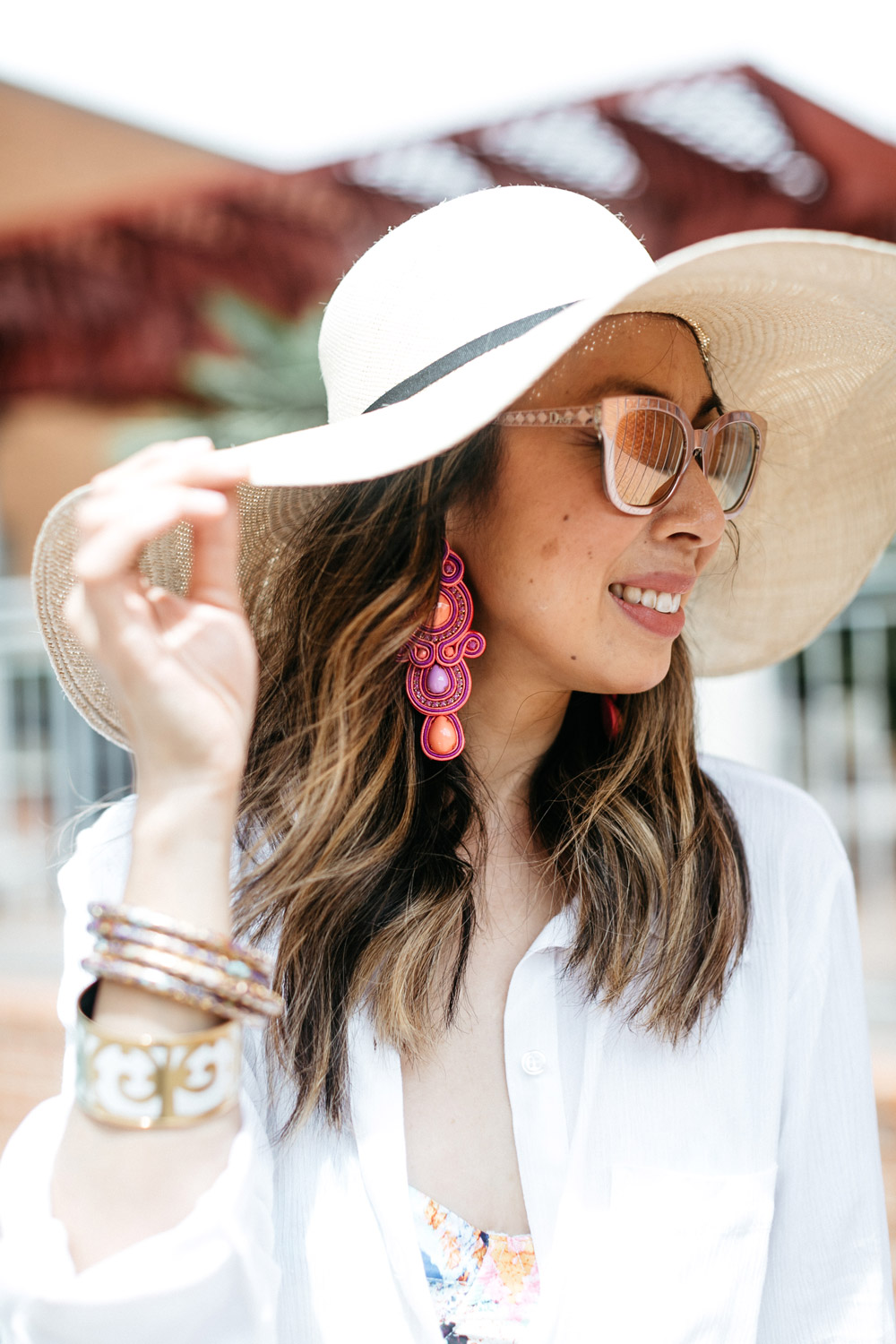 cuyana oversized beach hat alejandra aspillaga statement earrings dior diorama caged sunglasses