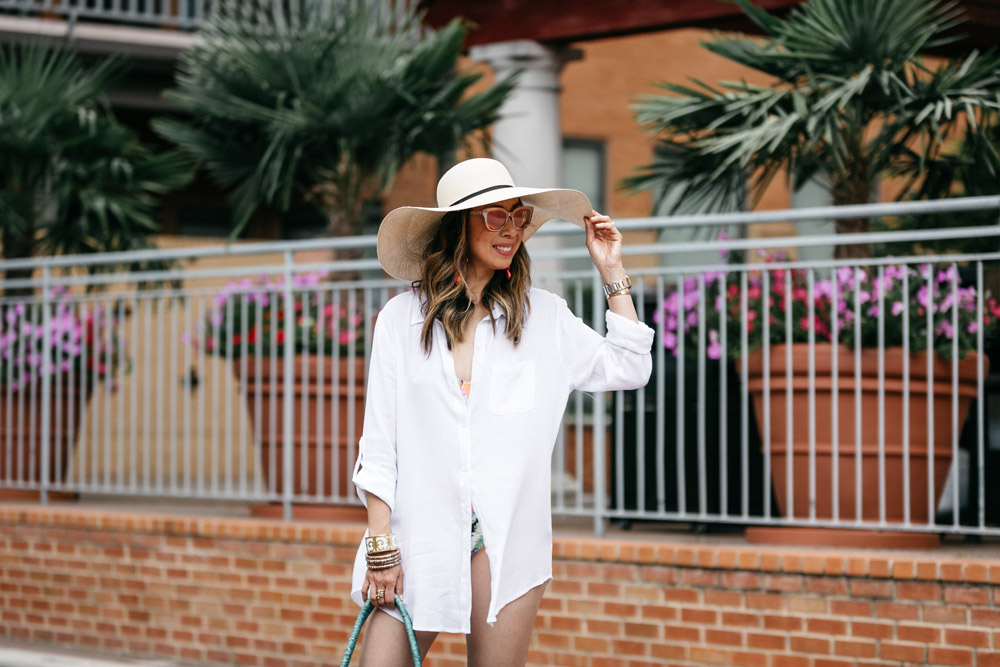cuyana beach hat white button up swim coverup colorful beach bag alejandra aspillaga statement earrings jack rogers cork gold flip flops