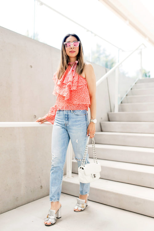 rosie assoulin corkscrew one shoulder ruffle top dupe levi's wedgie jeans gucci silver mules chanel white flap dior diorama cage sunglasses