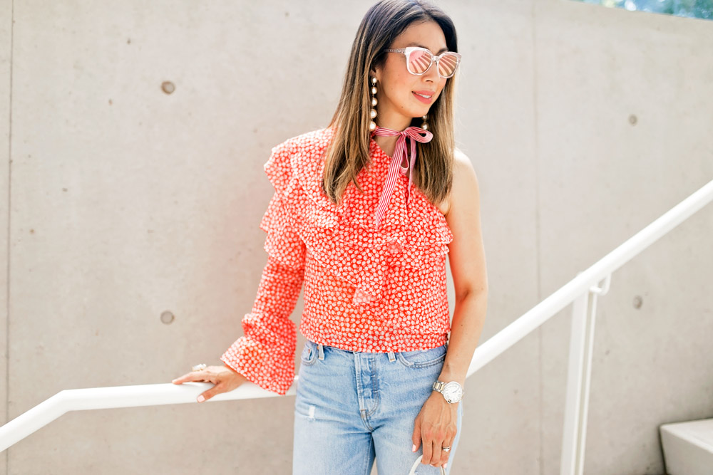 rosie assoulin corkscrew one shoulder ruffle top dupe levi's wedgie jeans pearl drop earrings dior diorama cage sunglasses