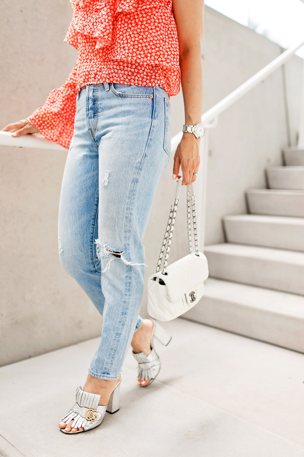 rosie assoulin corkscrew one shoulder ruffle top dupe levi's wedgie jeans gucci silver mules chanel white flap