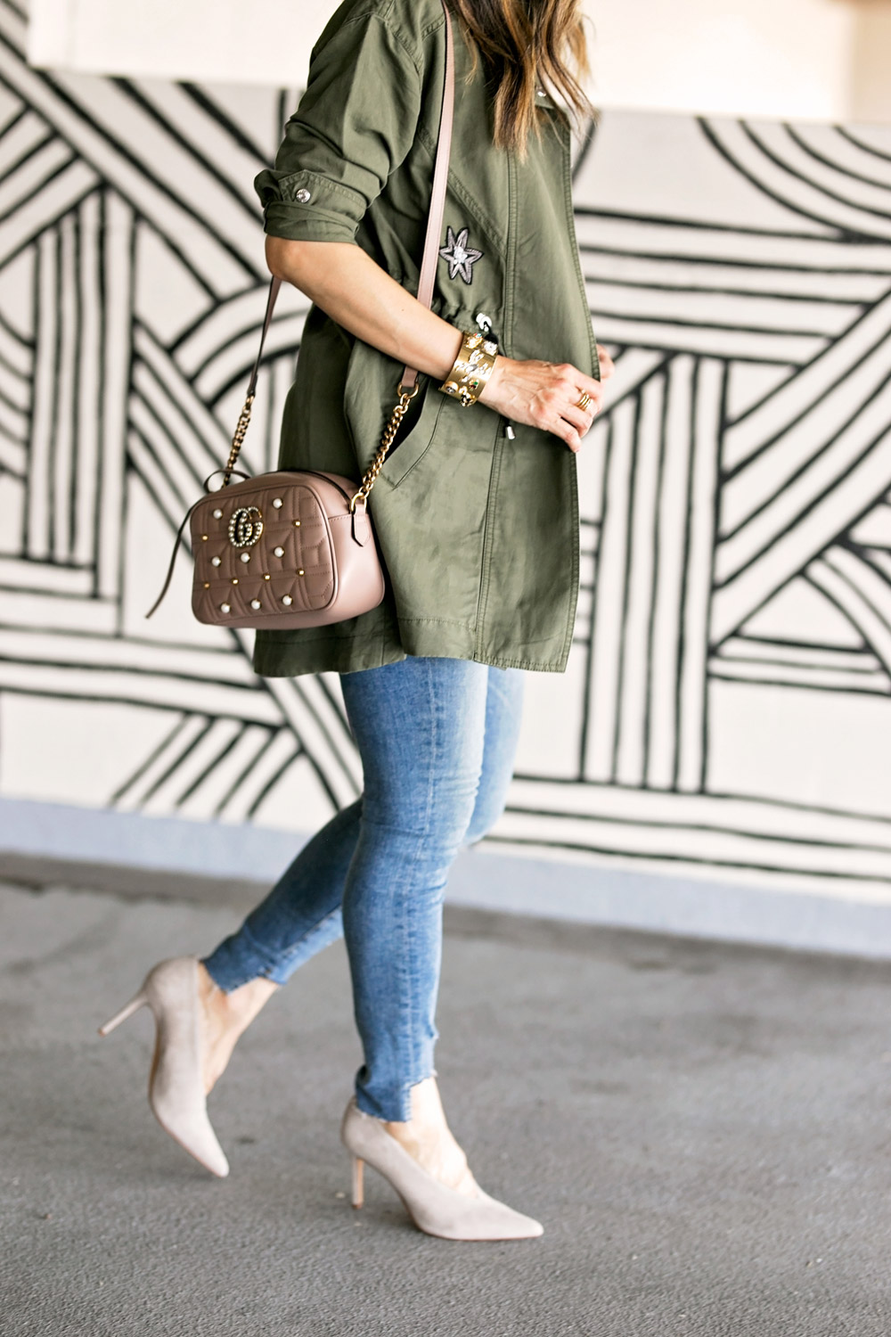 cabi hanson anorak embellished army green jacket white tee good american high waist skinny jeans vince camuto ankia pump gucci marmont pearl camera bag