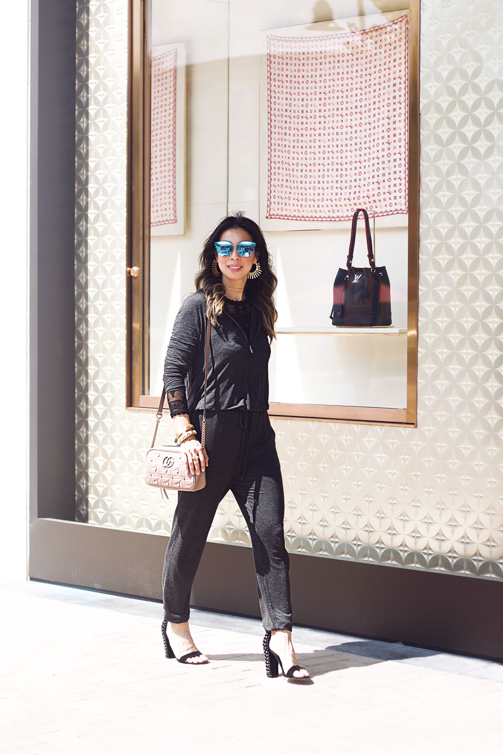 cabi hooded playsuit black lace top homini apollo earrings gucci pearl marmont camera bag julie vos bracelets