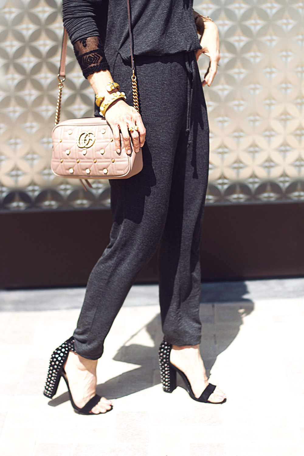 cabi hooded playsuit black lace top dolce vita studded sandals gucci pearl marmont camera bag julie vos bracelets