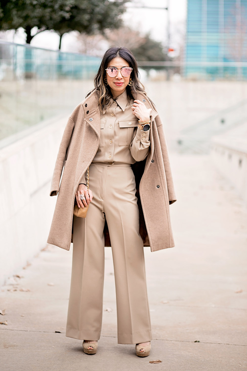 camel coat and beige coord set chanel earrings