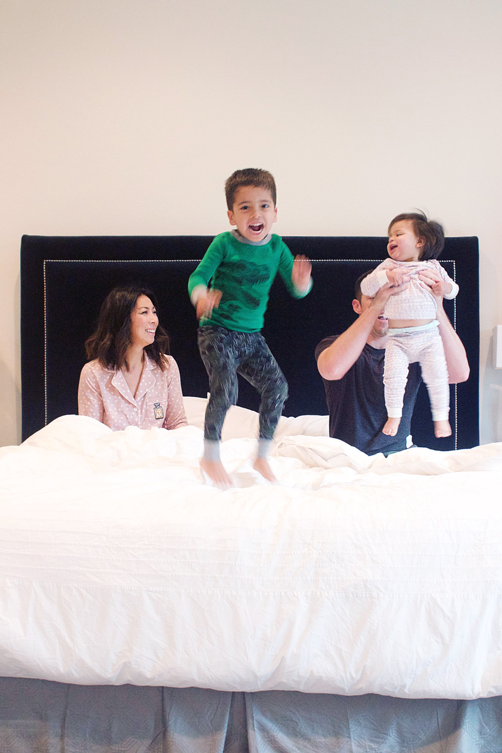 cute boy jumping on tomorrow sleep mattress in a box review with family