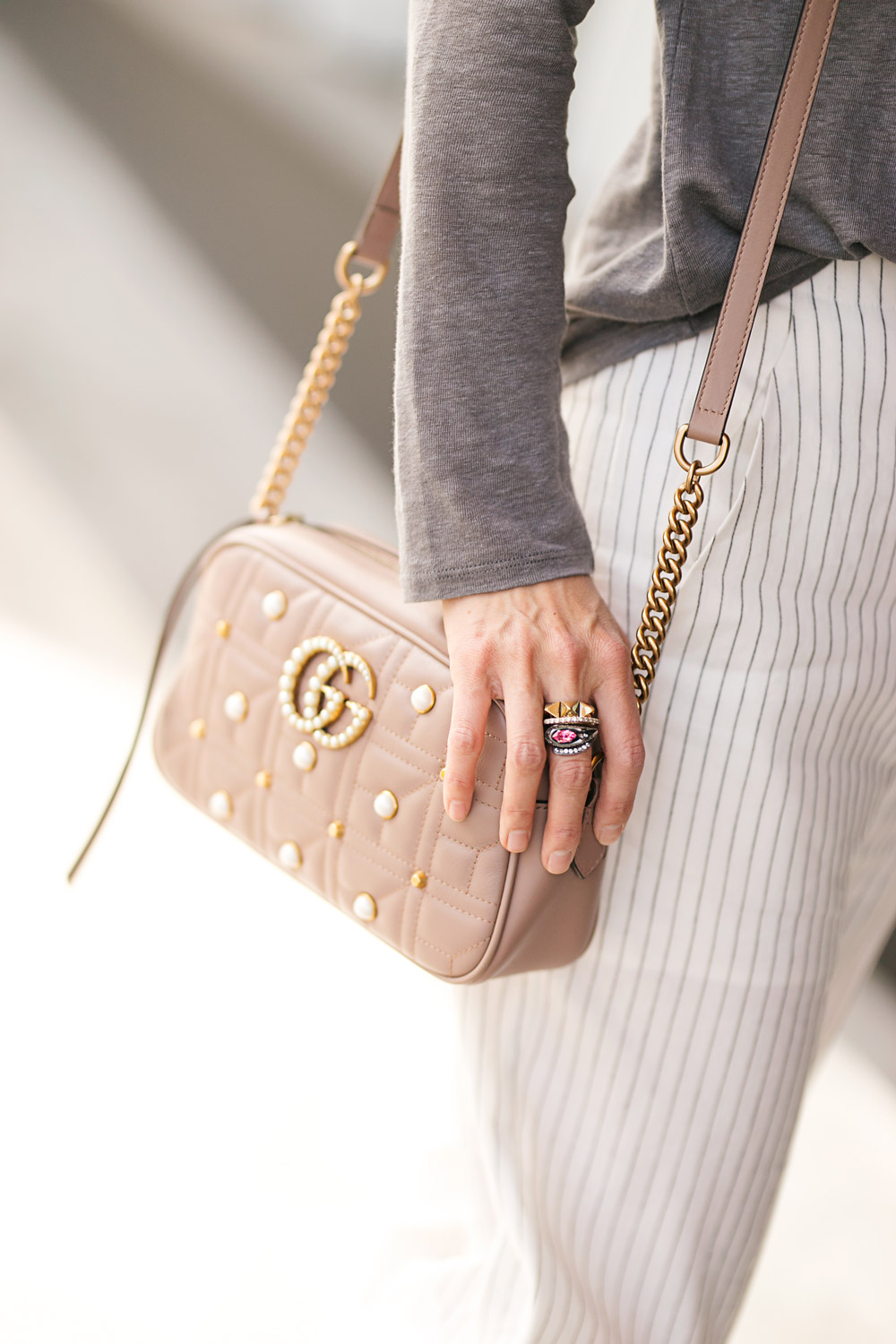 9f52386a6f25 style of sam in ruti asymmetrical top and pinstripe pants fort worth blogger  with gucci marmont pearl camera bag ...